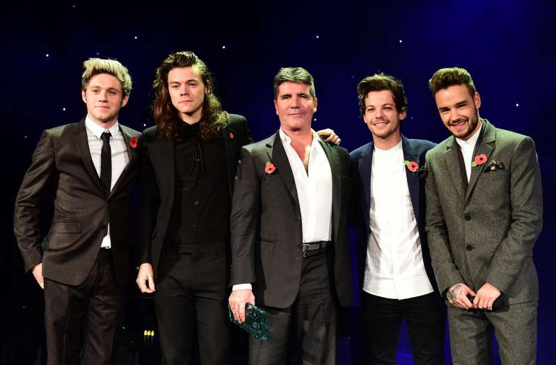 Niall Horan, Harry Styles, Simon Cowell, Louis Tomlinson, Liam Payne posing for a photo: The X Factor previously had huge success (Ian West/PA Archive/PA Images)
